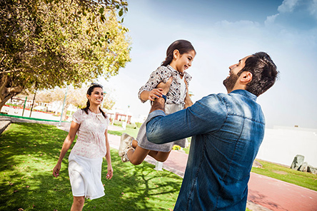 young-family-enjoying-outdoor-in-a-park